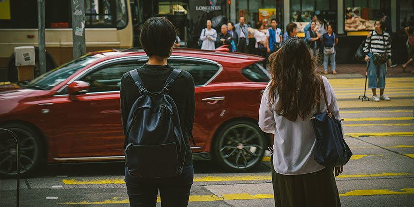 Young Urban Couple Crossing Street